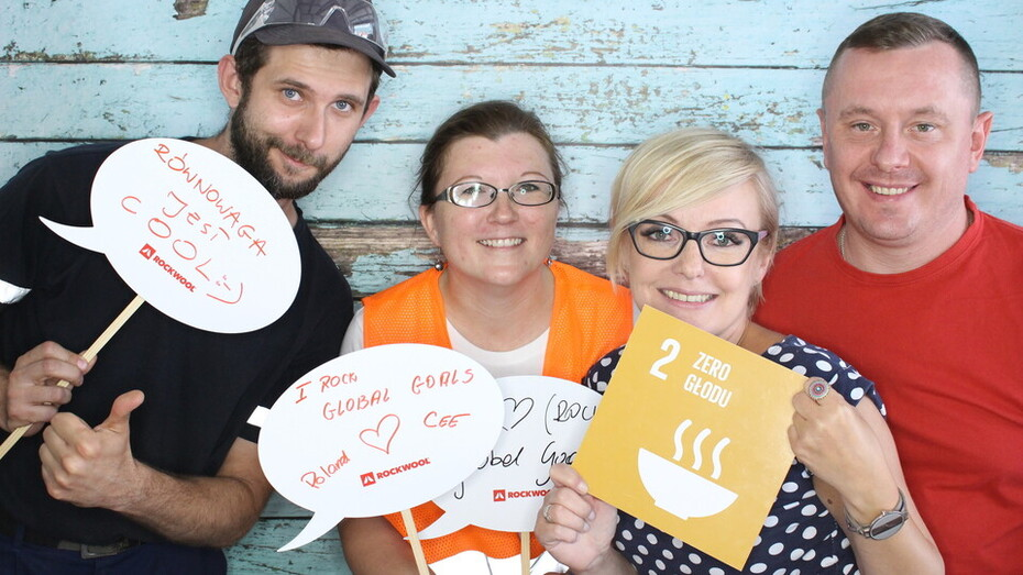 Four employees holding Sustainable Development Goals signs for the #iRockGlobalGoals campaign. Keywords: Sustainable Development Goals, SDGs, Global Goals, Sustainability, Employees, Employee